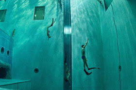 "Students swim during an apnea course by Italian free diver, Umberto Pelizzari, at the ""Y-40 The Deep Joy"" swimming pool on December 8, 2014 in Montegrotto Terme, northeastern Italy. The swimming pool is built over thermal sources bringing after cooling down a water at 32-34 degrees Celsius. Y-40, with its depth of 42mt, is officially included in the Guinness World Record as the deepest pool in the world for free and scuba diving.  AFP PHOTO / OLIVIER MORIN"