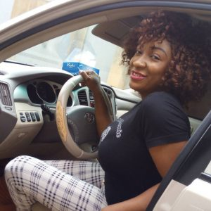Sanyeri's wife in her new car