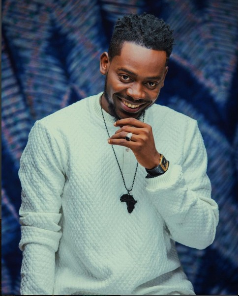 Fan Blasts Adekunle Gold For Not 'Brushing His Teeth'