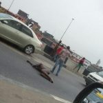 Unidentified Man Lies In The Middle Lagos Bridge Causing Major Traffic