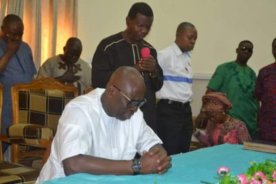 Fayose Kneels As Pastor Adeboye Prays For Him [PHOTOS]
