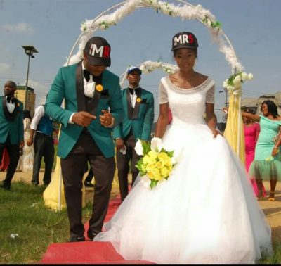 Couple Rocks Face Cap On Wedding Day [PHOTOS]
