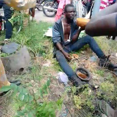 Man Faking Mental Illness Forced To Eat His Sacrifice, After Being Caught In Lagos