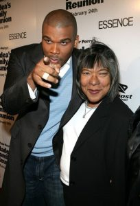 With his mother, Maxine