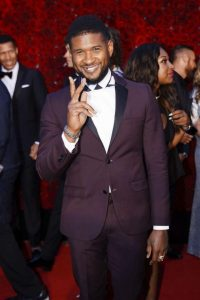 Usher at the ceremony