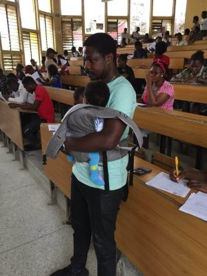 University Of Calabar Lecturer Seen Babysitting Student's Twins During An Exam