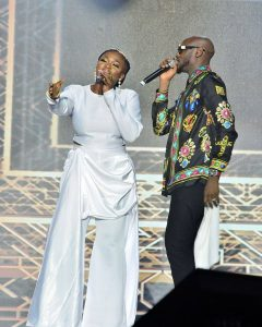 Waje and 2Baba performing on stage