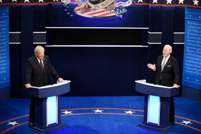"""Jim Carrey, right, joined Alec Baldwin in a parody of the first 2020 presidential debate for the Season 46 premiere of """"S.N.L.""""Credit...Will Heath/NBC"""